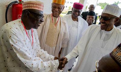 Buhari shaking Ahmed Makarfi