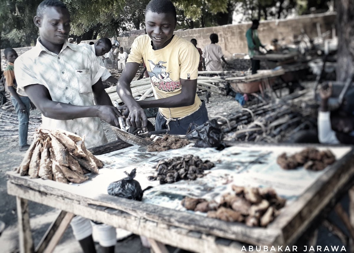 More Muhammed sells fish in baga road alongside his friend helping him,Borno State.