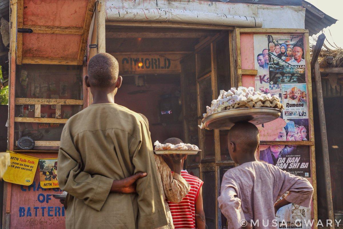 Groundnut sellers watching TV during their break time after hawking at Tashan Bama area Maiduguri.