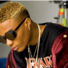 Wizkid shares new photo as he rocks a 'million dollar' holster in his Ferrari