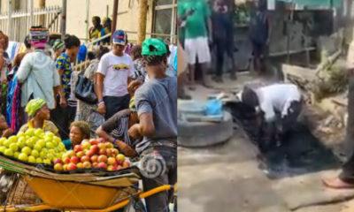 Popular fruit seller in Lekki caught preserving fruits in gutter water (video)