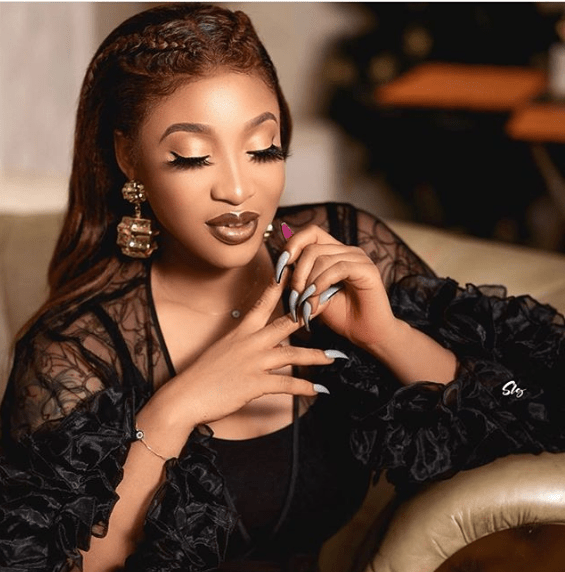 Why didn't you give her the money instead, Nigerians react as Tonto gifts her maid iPhone 11 (video)