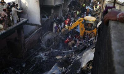 Pakistan plane plunges into Karachi residential structures, kills 97