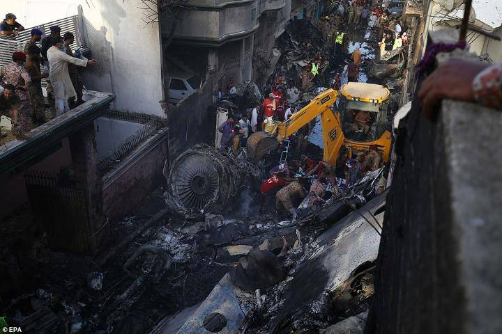 Pakistan plane plunges into Karachi residential structures, kills 97