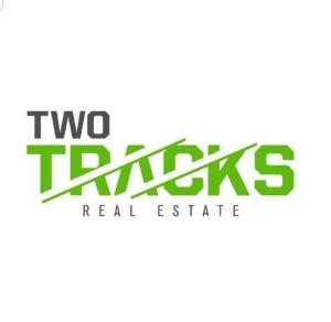 Two Tracks Real Estate Egypt Logo