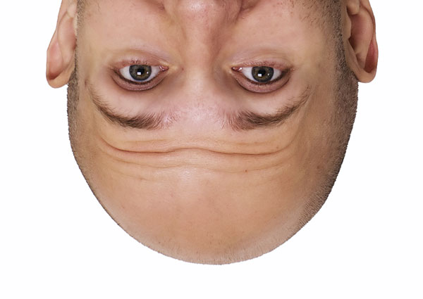 Upside Down Bald Man