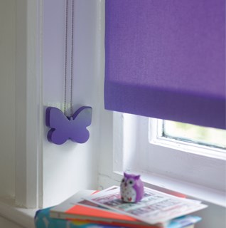 Designer blind cord safety devices to secure chain and cord operated blinds for child safety