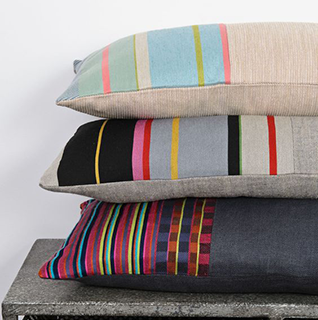 Designer colourful stripy, geometric or vintage Scandinavian and modern British cushions and throws.