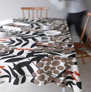 Soft feel oil cloth by the metre in vintage Scandinavian designs, machine washable at 40°C.