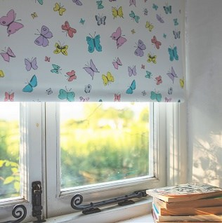 Roller blind prints and weaves in fresh vibrant colours to  transform a room with bright florals