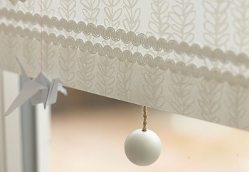 arco braid and wooden pull on white blind