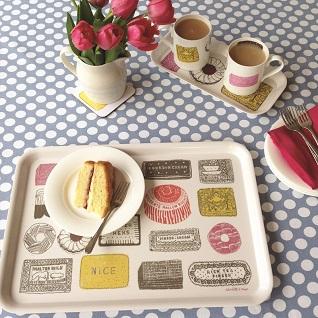 cake on a tray with matching mugs
