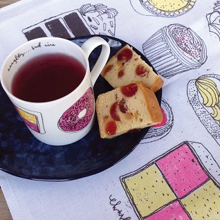 cake design on mug and tea towel with cake