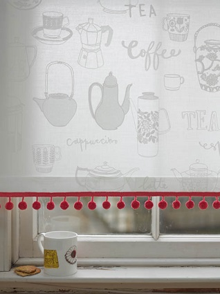 berry red pompom fringe on a white window blind