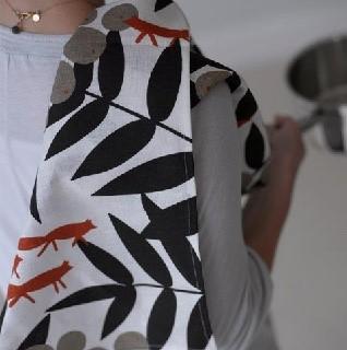 red fox tea towel over a shoulder