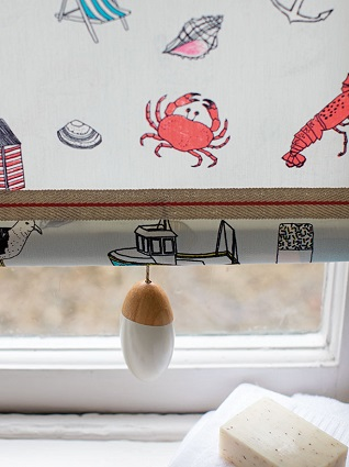 seaside blind with striped trim and pull