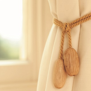 wooden pebble curtain holdback in natural wood