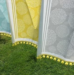 asha tea towels and yellow pompoms