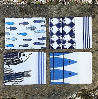blue and white fish tea towels