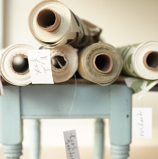 fabric by the metre rolls of fabric on table