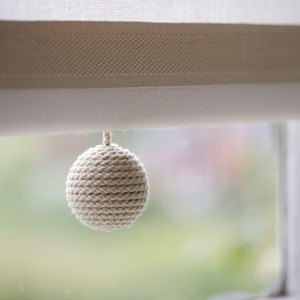 straw cream coloured carpet ball boule textile modern elegant wool window roller blind pull