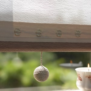 gorgeous pearl coloured classy charleston window blind pull with shiney texture