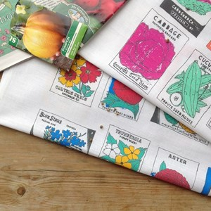 vegetable and flower gardener tea towel set showing lovely illustrations of vegetable and flower see