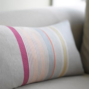 luxury striped woven cushion by Laura Fletcher in orange red ochre pink and greywool and cotto