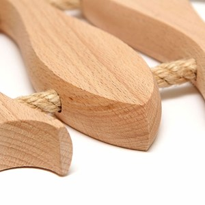 nautical style wooden kitchen trivet for the table with 3 fish shaped lathes and rope handles