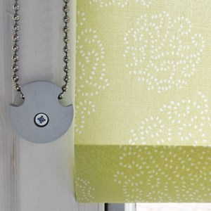 roller roman blind and curtain strong metal child safety device to safely hold cords or chain in gre