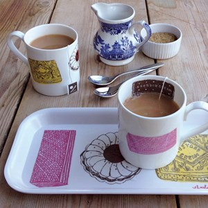 family favourites biscuit mug and drinks tray gift set in red black yellow pink by british designer