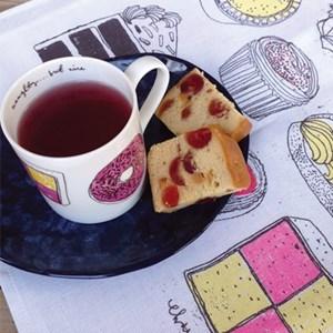 naughty but nice cake mug and tea towel gift set with favourite cakes