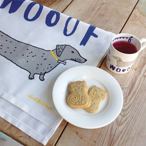 wooof daschund susage dog mug and kitchen tea towel set for dog lovers by charlotte farmer