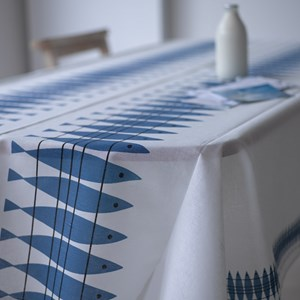 blue and white oil cloth featuring Swedish vintage retro design of fish sill.