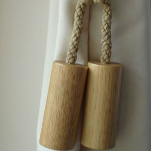 large natural wood cylinder curtain tieback for a great modern look