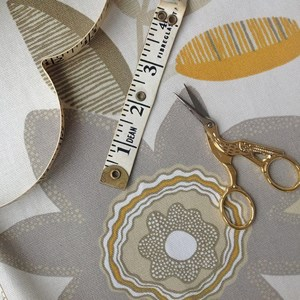 Beige botanic print by Teija Bruhn that's printed in Sweden on 100% cotton.