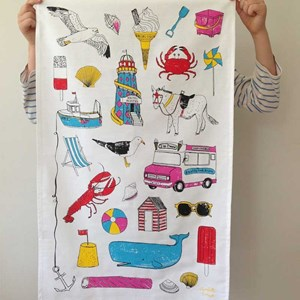 seaside fun tea towel by British designer charlotte farmer featuring summer sunglasses crabs trawler