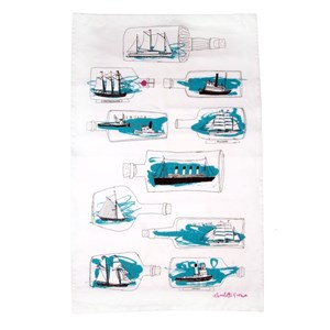 ship ahoy tea towel by illustrator charlotte farmer, showing many drawings of blue ships-in-bottles