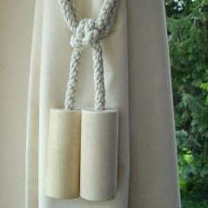 whitewashed wooden cylinder curtain tieback with cotton embrace