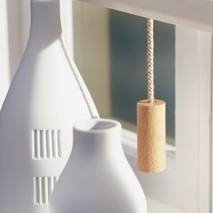 natural colour cylinder quality interior window blind pull in stained natural beech wood