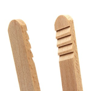 wooden kitchen salad tongs or server in natural wood