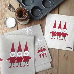nordic elves tea towel and washing up cloth gift set, featuring santas helpers and snowflakes in red
