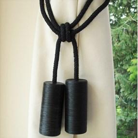black leather cylinder curtain tieback or hold-back