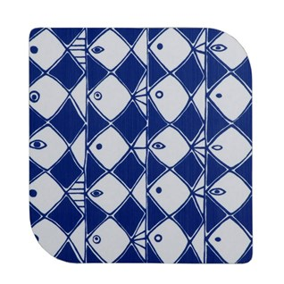 blue and white fish design trivet or heatproof mat in unusual shape