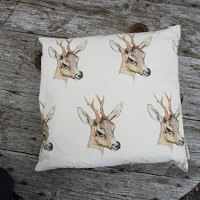Deer print cotton cushion with design of a deers head