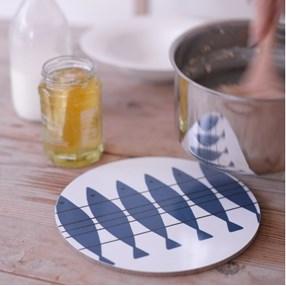 blue and white heat proof kitchen trivet of vintage fish design