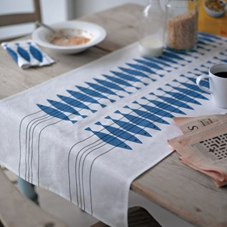 blue and white cotton/linen table runner in classic Swedish design of herring fish