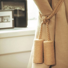 undyed natural jute cylinder curtain tieback or hold-back