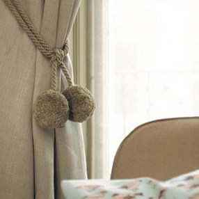 soft pompom wooliy curtain tieback and hold-back in moss green colour with cotton rope embrace