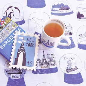 snow globe mug and kitchen tea towel in blue and white